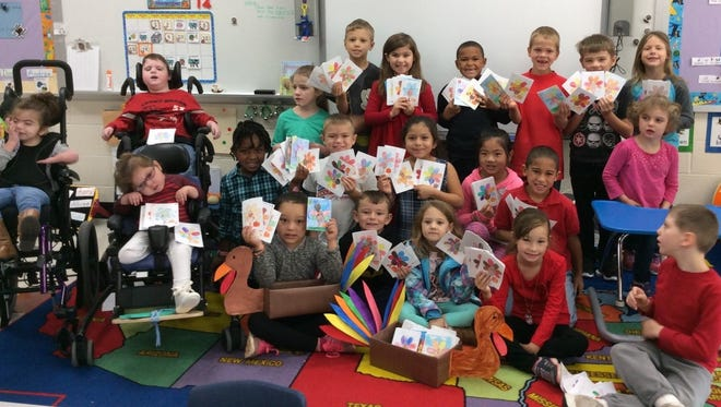 Shown are students in Marci Mim's and Gail Patton' s class with their colored Thanksgiving  cards. This project has been ongoing at Palmetto Elementary School since 2002.