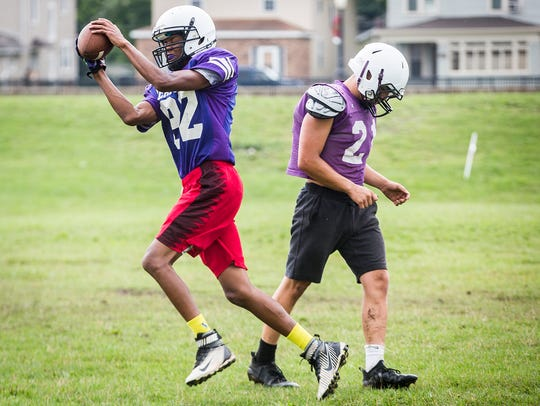 Central football players work through drills during