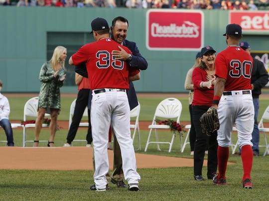May 20, 2016; Boston, MA, USA; 2016 Red Sox Hall of Fame inductee Tim Wakefield reacts with Boston Red Sox starting pitcher Steven Wright (35) after throwing out the first pitch with fellow inductees Jason Varitek & Larry Lucchino (not pictured) before the start of the game against the Cleveland Indians at Fenway Park. Mandatory Credit: David Butler II-USA TODAY Sports