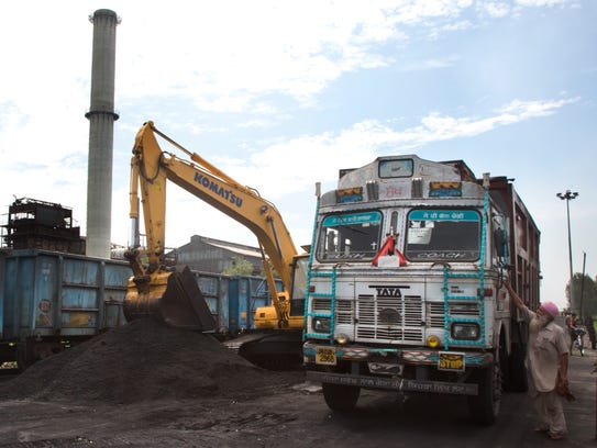 Domestically produced petroleum coke is loaded onto