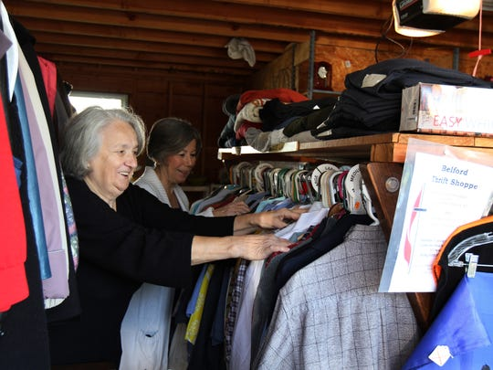 (right) Belford United Methodist Church trustees president Arliene Zaborney and (left) Carol Geurtse, the church's financial secretary, tag items to sell at the Belford Thrift Shoppe, located behind the church, which is celebrating its 150th anniversary this weekend amid plummeting membership and other challenges, in Belford, NJ Thursday October 22, 2015.