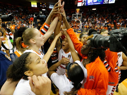 UTEP guard Chrishauna Parker is surrounded by her teammates