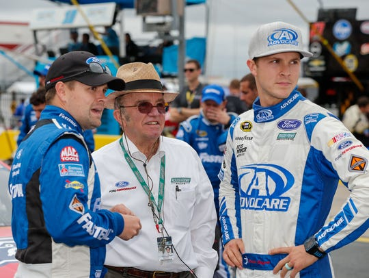 Trevor Bayne, right, with team owner Jack Roush, center,