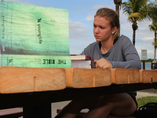 Florida Gulf Coast University sophomore Taylor Briggs, 18, participates in a Bible study last week outside North Lake Village, a student residential community on the FGCU campus. The school plans to improve the area by building a dining facility and enhancing the outdoor area.