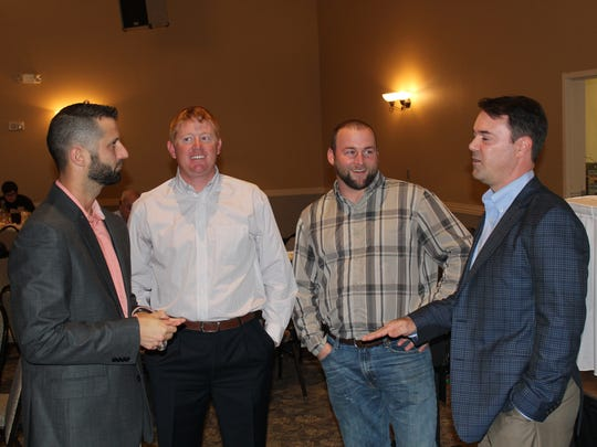 Former MLB player Warren Morris (right) speaks to attendees of Louisiana College's First Pitch Banquet Monday.