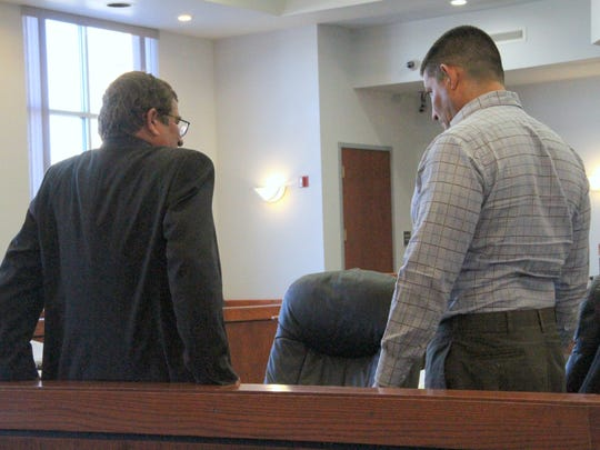 Joe D. Chavez Jr. (R) talks to his defense attorney in 12th Judicial District Court Wednesday. Chavez was found guilty Friday of accessory to murder, conspiracy, arson and tampering in the 2011 death of Richard Valdez.