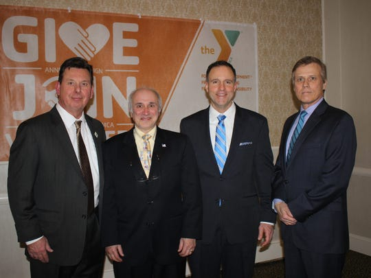 Somerset County YMCA receives support from local officials. (l-r) Board President Mark Irwin, Franklin Township Mayor Phillip Kramer, President and CEO, David M. Carcieri and Franklin Township Councilman James Vassanella.