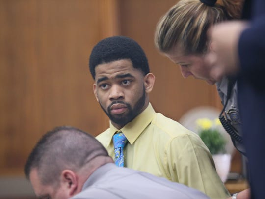 Dominique Heaggan-Brown is seated in court Monday on the first day of his trial on first-degree reckless homicide in the fatal shooting of Sylville Smith. Heaggan-Brown has since been fired as a Milwaukee police officer.