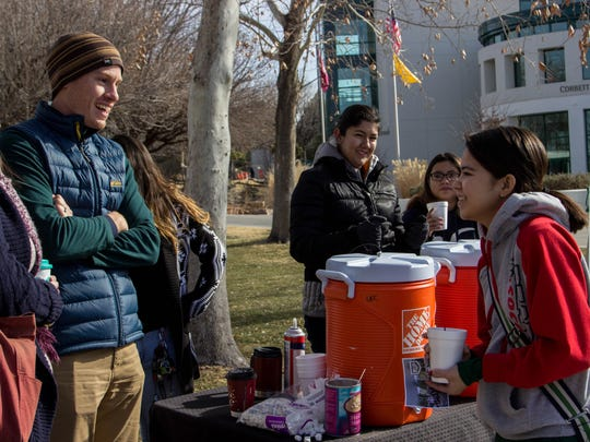 Reformed University Fellowship campus minister Jonathan Clark welcomes NMSU students back to campus with fresh coffee and hot cocoa on Wednesday, Jan. 17, 2018.