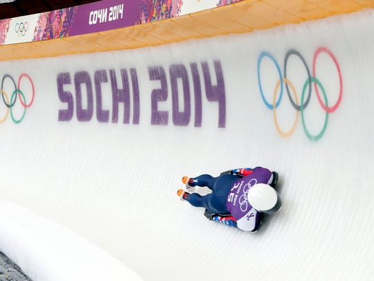 Skeleton sliders race on a bobsled track facefirst on a sled at speeds of up to 80 mph.