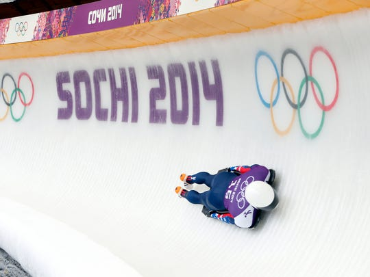 Feb 11, 2014; Krasnaya Polyana, RUSSIA; Matthew Antoine (USA) practices in a training run for men's skeleton during the Sochi 2014 Olympic Winter Games at Sanki Sliding Center. Mandatory Credit: Kevin Jairaj-USA TODAY Sports