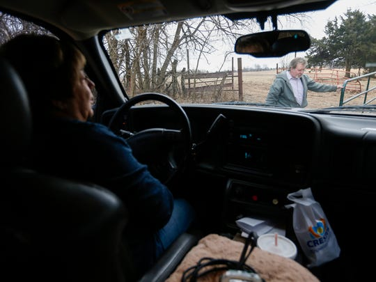 Brad Jennings opens the gate to check on his cattle at his home in Buffalo as his sister Marsha Iler waits in the truck on Tuesday, Feb. 13, 2018. Jennings had been in prison since 2009 before a judge threw out his murder conviction.