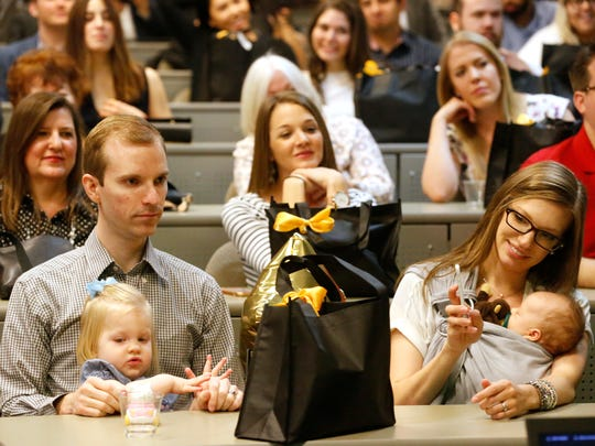 Christian Draper sits with his daughter, Lacey Draper, 2, and his wife and other daughter during the 2018 Match Day celebration Friday. Draper was among the 90 students from the Paul L. Foster School of Medicine, the largest graduating class yet, who applied to residency programs throughout the country. Their matches included prestigious institutions like George Washington University, Baylor University; the University of California Irvine, Texas A&M, and New York University.
