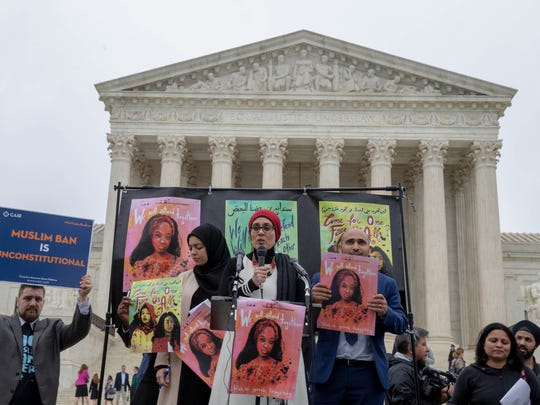 Protesters gathered outside the Supreme Court Wednesday as the justices heard oral arguments on President Trump's travel ban.