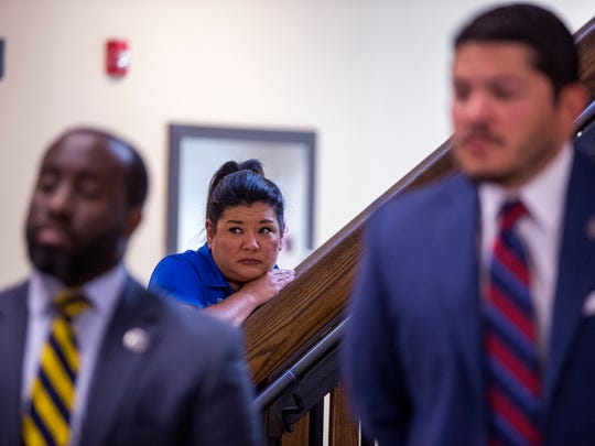 Sandwiched between Matt Manning (left), first assistant of courts with the Nueces County District Attorney's Office, and District Attorney Mark Gonzalez (right), a woman listens as the new prosecutors for a Domestic Violence Bureau are introduced during a press conference at the Nueces County Courthouse on Friday, April 27, 2018.
