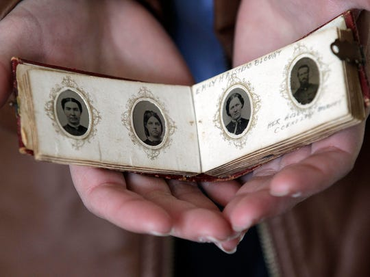 A soldier's compact photo album is part of a Civil War exhibit at the Neenah Historical Society.