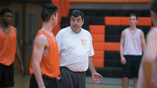 Corona del Sol's coach Neil MacDonald instructs the team during practice at Corona del Sol in Tempe on Nov. 9, 2015.