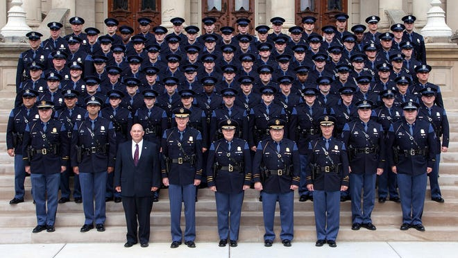 Sixty-two new Michigan State Police troopers reported for their first day of work at posts across the state Monday. Among those is Brighton resident Cole Hodge, who has been assigned to the Iron Mountain Post. Two new recruits are assigned to the Brighton Post.