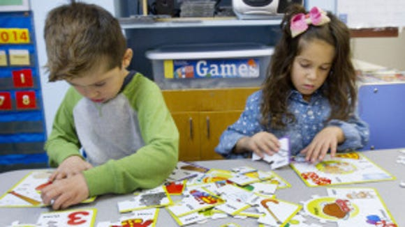 At the Peppermint Tree Preschool in Toms River, Jonathan Orozco, 5, and Adrianna Raffo, 6, both from Toms River, work on a puzzle in November.