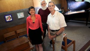 """Attendees of a new secular """"church"""" called Sunday Assembly Madison will meet monthly in rented space at Prairie Unitarian Universalist Society. Pictured at Prairie's meeting house are Sunday Assembly founders, from left, Naomi Kroth, Robert Bank, and Eric Snyder."""