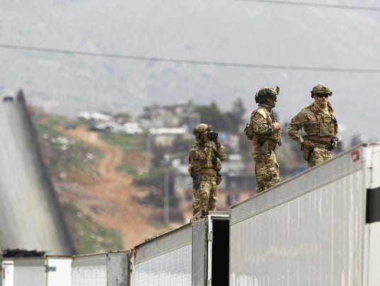 Guard units at the border won't be armed, administration tells Mexico