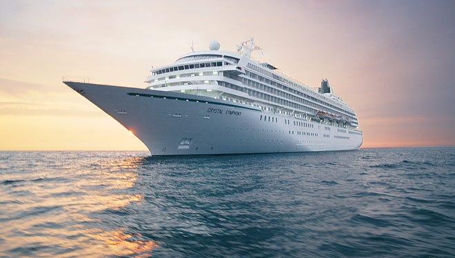 Crystal Symphony cruises at sunset.