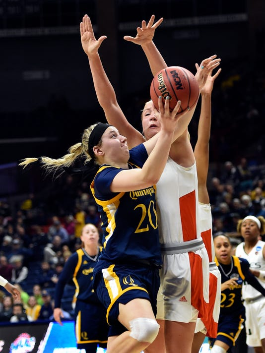 Quinnipiac's Paige Warfel (20) shoots against Miami's Leah Purvis (21) during a first-round game in the NCAA women's college basketball tournament in Storrs, Conn. Saturday, March 17, 2018. (AP Photo/Stephen Dunn)