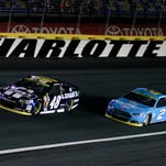 Jimmie Johnson (48) and Brad Keselowski race during the Bank of America 500 at Charlotte Motor Speedway last weekend. Both were in the news after the race for different reasons.