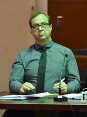 University of Guam professor Michael B. Ehlert listens