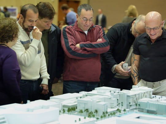 Palm Springs residents look over a model of the planned  downtown Palm Springs during a development study session on Wednesday, January 6, 2016 at the Palm Springs Convention Center.