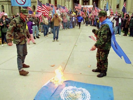 Members of the Michigan Militia set fire to a United