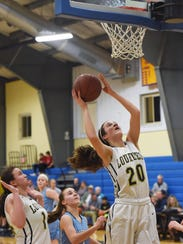 Lourdes' Madison Siegrist, right, goes for a layup