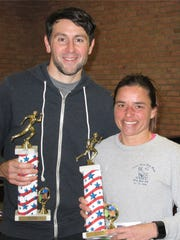 Men's and women's overall winners of the Pete Sanfilippo Winter Run, Beacon's Phil Shea and Wappingers Falls' Rose Tullo, pose together after the race Sunday.