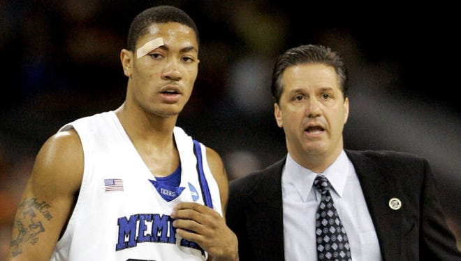 Then-Memphis coach John Calipari talks with Memphis guard Derrick Rose (23) in the first half of the NCAA South Regional basketball final, in Houston on March 30, 2008. Rose, who led Memphis to the 2008 national title game, appears to be at the center of an NCAA investigation of major violations during that season.