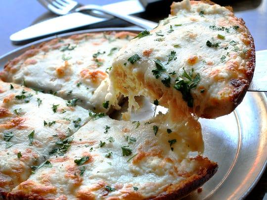 The deep dish quattro formaggio (four cheese pizza