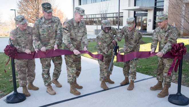 Cutting the ribbon at Thursday's ceremony at Blanchfield Army Community Hospital are, from left, U.S. Army Corps of Engineers Col. Robert Ruch and Col. Christopher Beck; Maj. Gen. Gary J. Volesky, commanding general of 101st Airborne Division and Fort Campbell; BACH commander Col. Telita Crosland; Maj. Gen. Steve Jones, commanding general of U.S. Army Medical Department Center and School and U.S. Army Health Readiness Center of Excellence; and  Maj. Olegario Coss of the Army's Health Facility Planning Agency.