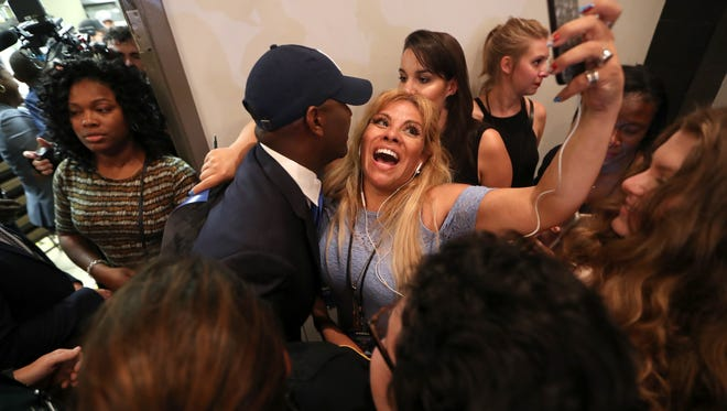 Fanny Fuentes takes a photo with democratic gubernatorial nominee Andrew Gillum as they celebrate his victory at Hotel Duval on Tuesday, Aug. 28, 2018.