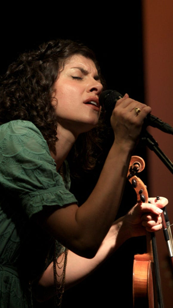 "Carrie Rodriguez performs in 2011 at Braun Books in Cedar City. Her album, ""Lola,"" was one of 2016's best records."