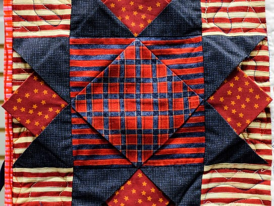 A quilt square from Jill Croley from Lansing is included