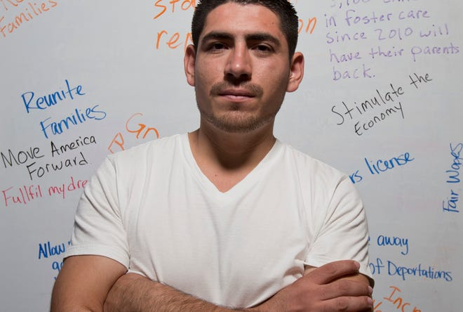 Jose Patino is surrounded words reflecting what he hopes immigration reform will help to accomplish. He is one of over 19,000 young undocumented immigrants who has received deferred action from deportation.