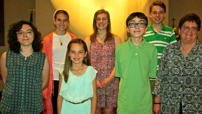 Piano students of Carol Hollich, Palmyra, recently presented a recital for relatives and friends at Trinity United Methodist Church in Lebanon. Participating in the program were: (front row, left to right), Bethany Kristich, Maya Wildasin, August Clements and Carol Hollich; (second row, left to right) Virginia Huffman, Meghan Buchle and Jacob Wildasin. Refreshments were served to the families afterwards.