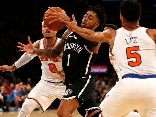 Knicks forward Michael Beasley and guard Courtney Lee defend against Brooklyn Nets guard D'Angelo Russell.