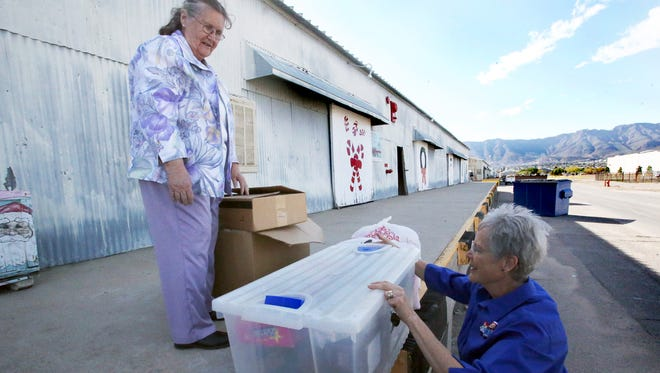 Janna Daniels, right, of the Sun Country Doll Folks drops off dolls and accessories to Sue Gonzales of Operation Santa Claus at Fort Bliss. The charity, started in 1957, takes new and gently used toy and bicycle donations to give to children of Fort Bliss soldiers and the Boys and Girls Club in South El Paso.