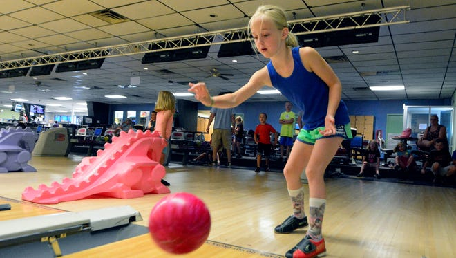Leisel Peterson, 6, of Dover, rolls the ball while bowling with family at Colony Park Lanes North, Friday, July 8, 2016 Colony Park currently has several youth bowling activities, including the Kids Bowl Free program.  John A. Pavoncello photo