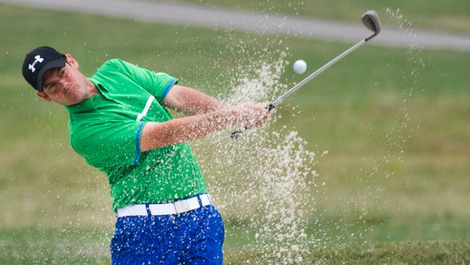 T.J. Ostrom hits out of a bunker during the second 2014 York County Amateur at Briarwood East Golf Course. Ostrom will be going for his fifth career York County Amateur title this weekend, with the tournament being played at Royal Manchester Golf Links.
