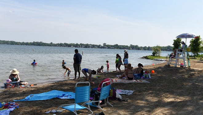 Beach and hot weather worshippers visit Novi's Lakeshore Park on June 12 for some sun and sand.