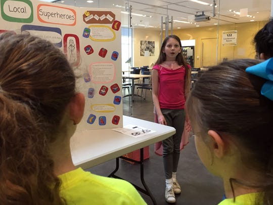 "Isabella Dini, a seventh-grader from the Tatnall school, explains how you can be a ""local superhero"" by doing things like eating organic food."