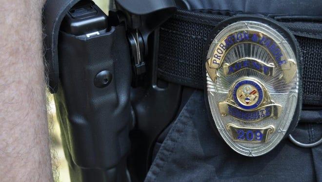 Harry Nuccio's badge announces his status as a law enforcement officer.