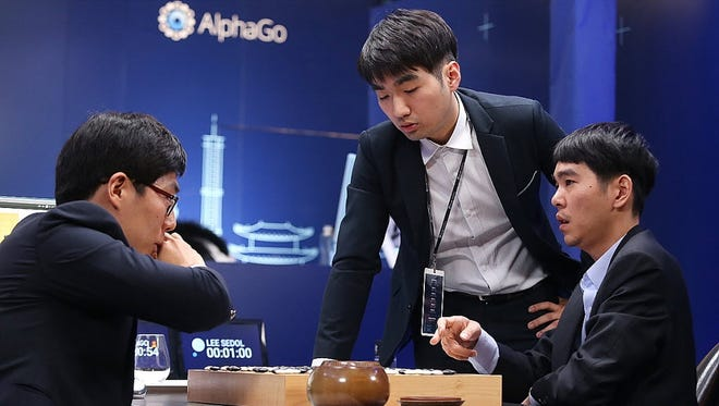 Professional South Korean Go players review a match after another bout lost to a computer in the Google DeepMind Challenge Match.