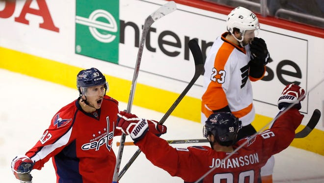 Washington Capitals center Jay Beagle celebrates with teammate Marcus Johansson (90) after scoring a goal against the Philadelphia Flyers in the third period in Game 1 of the first round of the Stanley Cup playoffs.